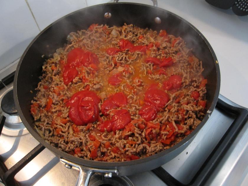 Pour tomato paste